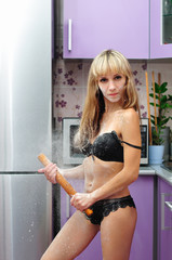 Wicked girl in lingerie with a rolling pin
