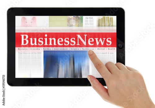 Hand scrolling digital news on tablet computer