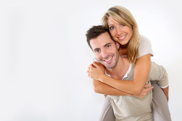 Cheerful couple standing on white background