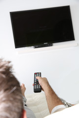 Closeup of remote control and tv set