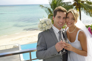 Just married couple holding glass of champagne