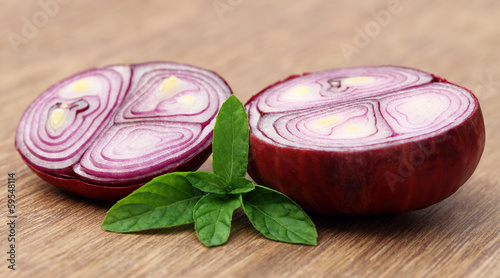 Sliced onion with mint leaves