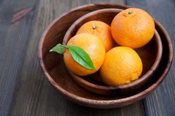 Tangerines in a wooden plate