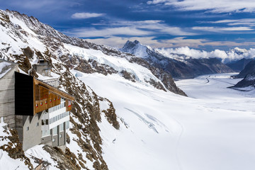 Hotel against the Aletsch glacier. Swiss Alps.