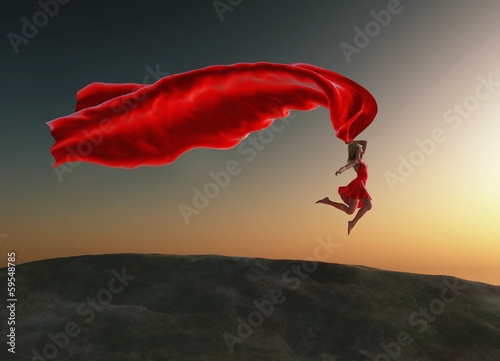 woman jumping with a red tissue