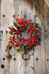 Christmas wreath on an old wood door