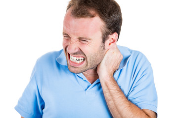 Stressed man having a really bad neck pain