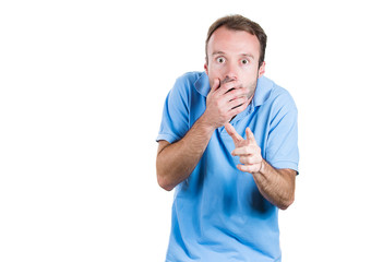 Shocked, scared man covering his mouth, pointing at you