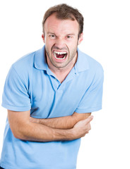 Angry, man with severe stomach pain, screaming out loud
