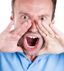 Angry, mad, upset young man screaming out loud