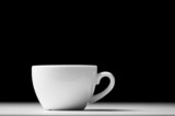 Defocused lights as aroma emanates from white coffee cup