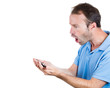 Shocked man holding mobile smart phone, receiving bad news