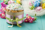 Easter cake, pink flowers and painted eggs