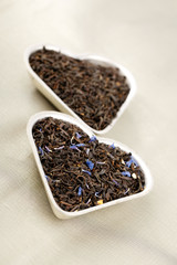 Earl Grey and Lady Grey black loose tea leaves in heart shape,on