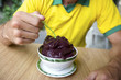 Brazilian Man Eating Bowl of Acai