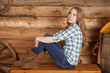 woman plaid shirt sit side legs up wood