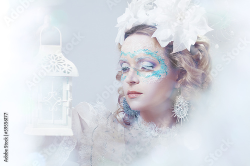 beautiful woman with winter style makeup and lantern