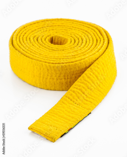 yellow strap in martial arts isolated on white