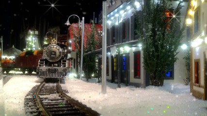 Toy train with Christmas gifts.