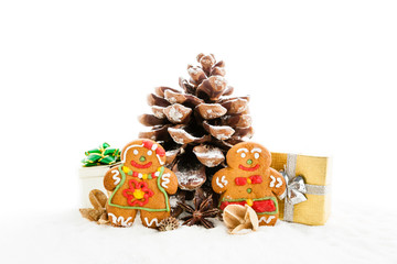 christmas pine cone tree and ginger cookies over white