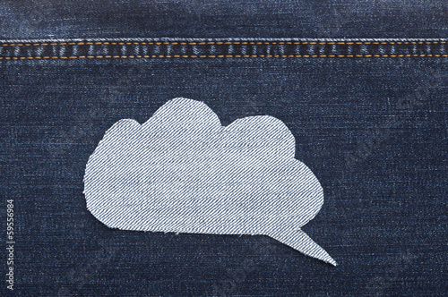 speech bubble jeans fabric on blue jean background