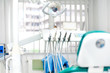 Modern dental clinic with tools, patient chair and equipment