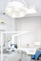 Dentist tools and equipment against white background
