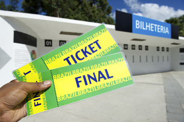 Soccer Fan Holds Two Brazil Tickets at the Stadium