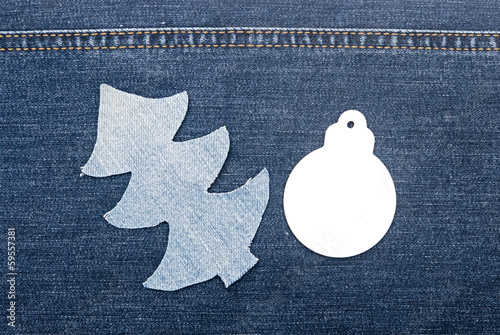 christmas background: jeans texture with shape Christmas tree.