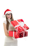 Happy teenage Santa girl opening a gift