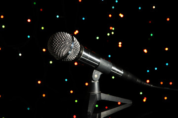 Microphone on stand on bright background