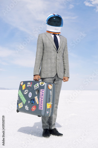 Businessman Astronaut Traveling on Moon Voyage with Suitcase