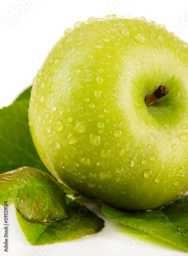 Juicy green apple with leaves, isolated on white