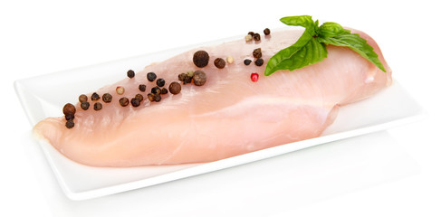 Raw chicken fillets on white plate, isolated on white