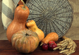 Pumpkins with apples and sheaf