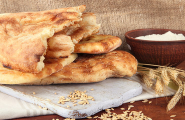 Pita breads with spikes and flour
