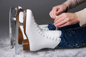 Skater wearing skates on gray background
