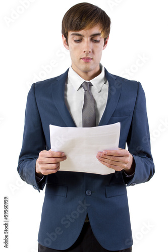 young businessman reading a presentation / press announcement