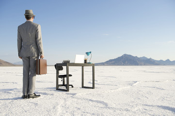 Businessman Arriving at Mobile Office Desk Outdoors