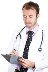 Confident male doctor taking patient notes