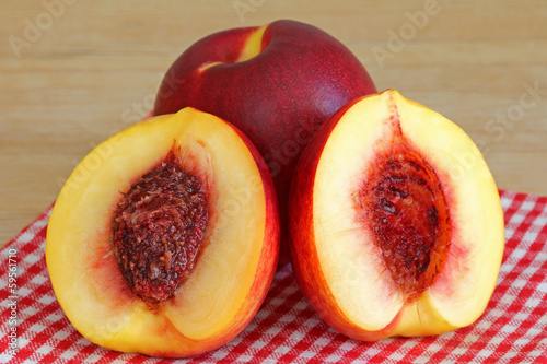 Fresh Nectarine cut in half showing a seed