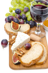 snacks - cheese, bread, figs, grapes, nuts and red wine