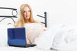 pregnancy woman awaking  with laptop