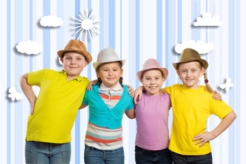 children in a row, wearing a hat