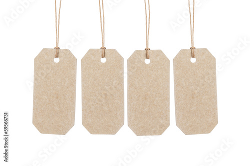 four brown tags hanging on ropes