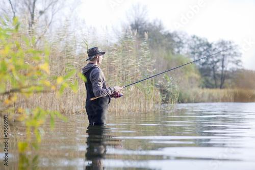 canvas print picture Angler im Wasser