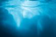 Leinwandbild Motiv Abstract blue background. Water with sunbeams
