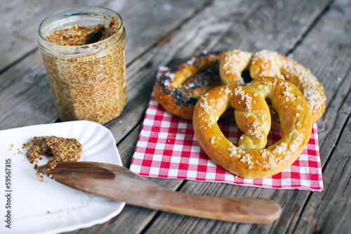 Pretzels with salt and grainy mustard, snack food for picknick