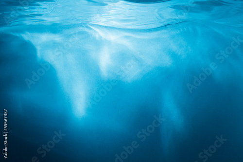 Abstract blue background. Water with sunbeams © Tim UR