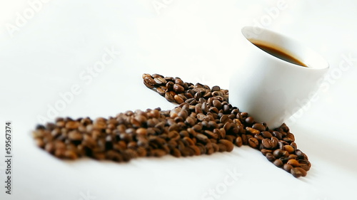 Coffee beans arrow with white cup on white background